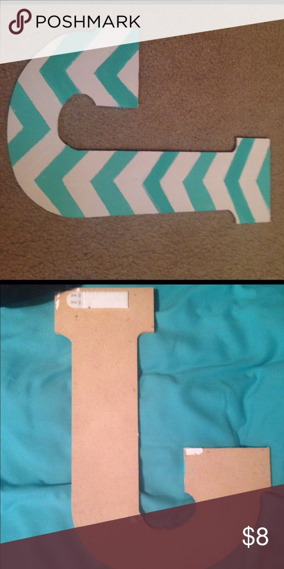 "Hand Painted Chevron J Letter Tiffany Blue & White Hand painted wooden letters that are approximately 13 inches. Paint is in a chevron style with tiffany blue/ aqua paint and white. Letters have a command velcro strip on back that can be attached to another strip and adhered to a wall. Letters ""M"" and ""C"" also available and will bundle! Hobby Lobby Other"