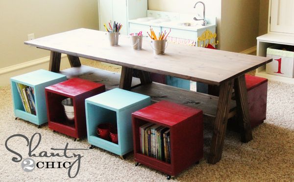 DIY Playroom Kids Table.  Love how they multipurposed the seats to be supply storage too.
