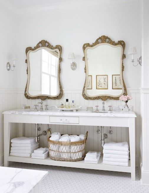 Double sinks, open shelving, ornate mirrors.