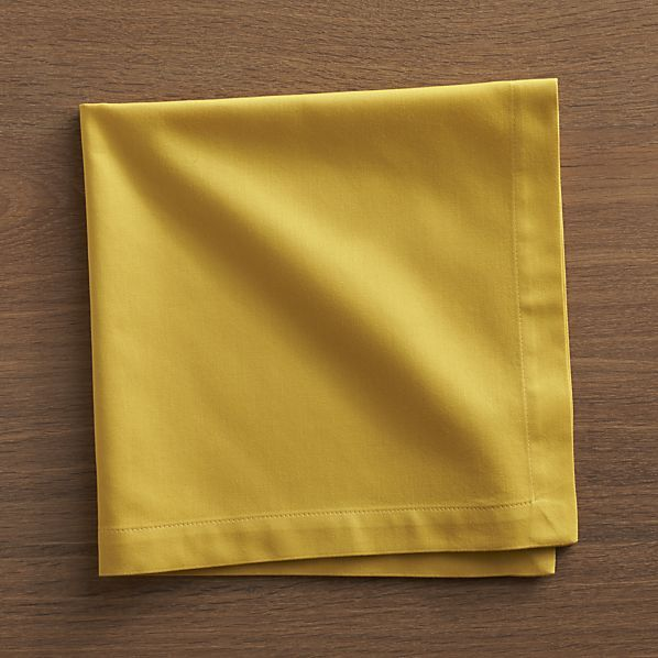 """Soft cotton napkins mix and match gorgeous tones of saturated color. Elegant yet easy-care napkin is tailor finished with 1"""" hem and mitered corners."""