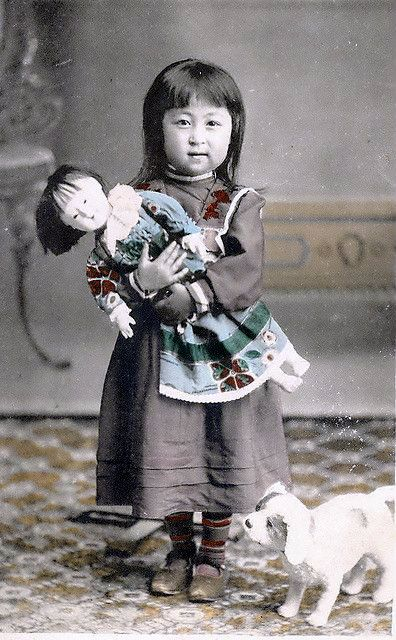 Adorable girl with her doll & doggie