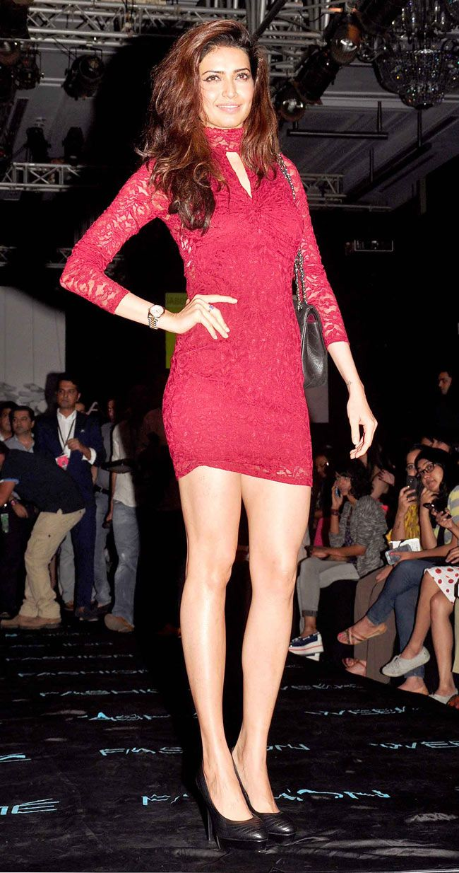 Karishma Tanna was hot in a red lace bodycon dress with black pumps at the Lakme Fashion Week Winter/Festive 2014 opener. #Bollywood #Fashion #Style #Beauty