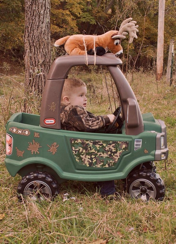 Bringing his kill in with his Cozy Coupe Truck.