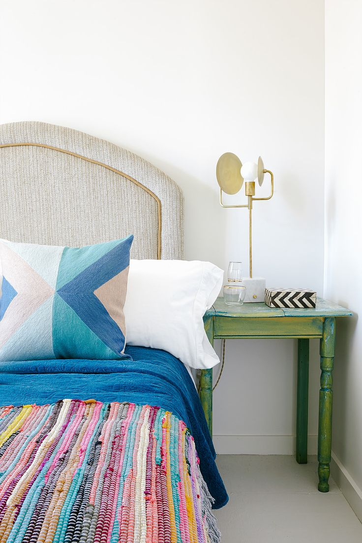 Everything about this colorful bedroom design screams fun and funky! For inspiration on how to mix patterns and give your home a playful style, look no further than this unique aesthetic.
