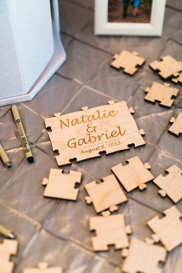 Puzzle piece wedding guest book keepsake | Elegant Disney Wedding at Four Seasons Hotel Silicon Valley | Annie Hall Photography | See more on My Hotel Wedding: https://www.myhotelwedding.com/blog/2016/04/11/elegant-disney-wedding-at-four-seasons-hotel-silicon-valley/