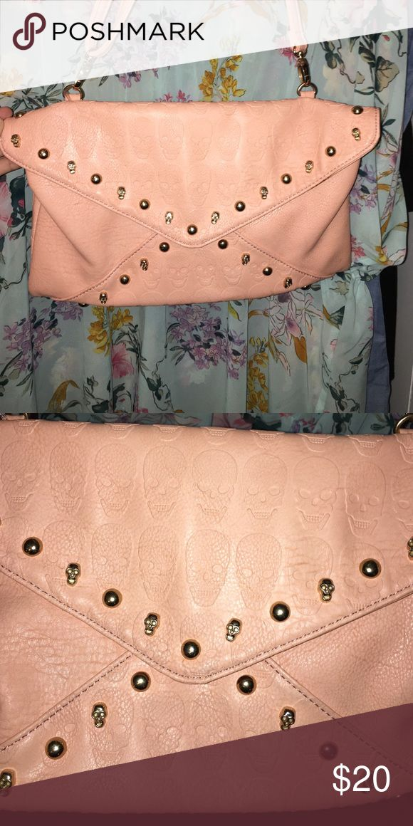 Skull Bag Really cute pink envelope skull bag! Can be worn for going out or everyday! Ive only used it a couple of times. Bags Clutches & Wristlets