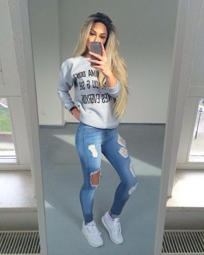 Casual cozy cute fall outfit ideas that anyone can wear teen girls or women. The ultimate fall fashion guide for high school or college. Comfy outfit with ripped jeans, sneakers and a gray sweater.
