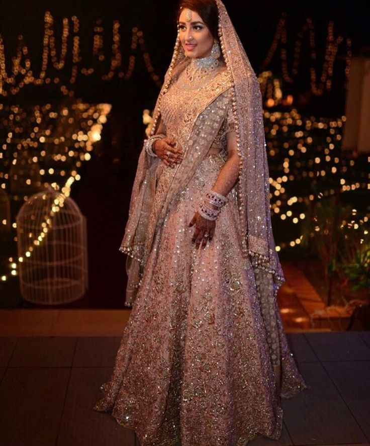 For the modern bride.. Glam and glitz lehenga from Manish Malhotra Peach n gold lehenga
