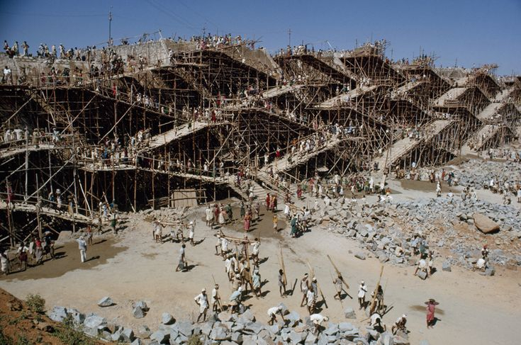 Workers swarm over scaffolding to erect the Nagarjuna Sagar dam in India, May 1963. PHOTOGRAPH BY JOHN SCOFIELD, NATIONAL GEOGRAPHIC