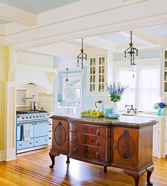 A 6-foot-long antique buffet repurposed as an island gives this kitchen a one-of-a-kind charm.
