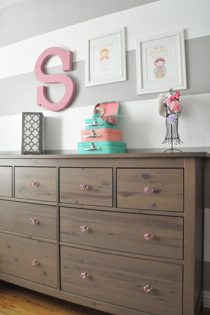IKEA Hemnes Dresser with Pink Knobs in a Bright Matryoshka Doll Nursery: