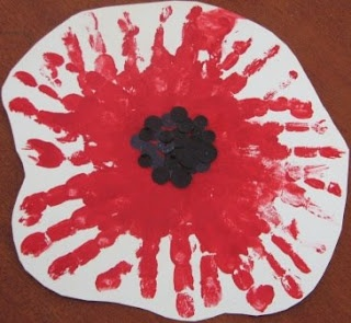 Poppy is a symbol of remembrance on Anzac Day whole punch black paper for middle bit