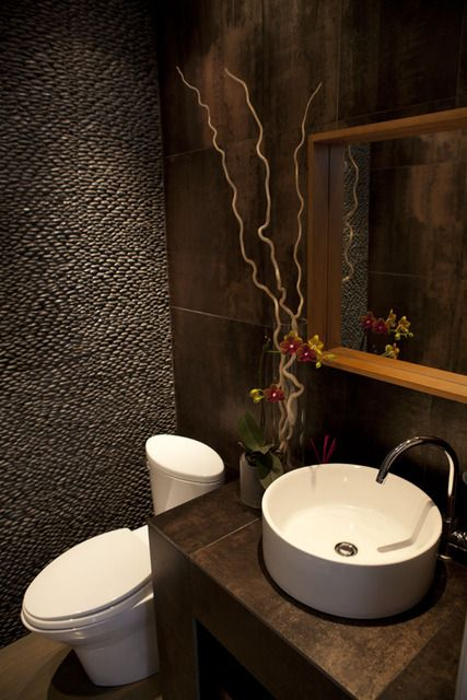*I love the pebble wall in this bathroom.  (Stathoulis)