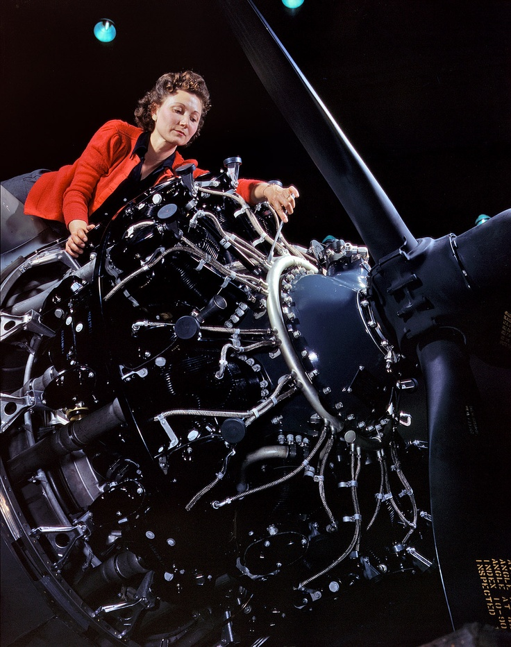 Working with my hands-Woman at work on motor, Douglas Aircraft Company, Long Beach, Calif. by Alfred Palmer