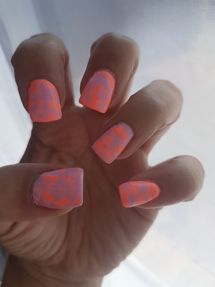 Bright orange with dash of pink/purple acrylic nails
