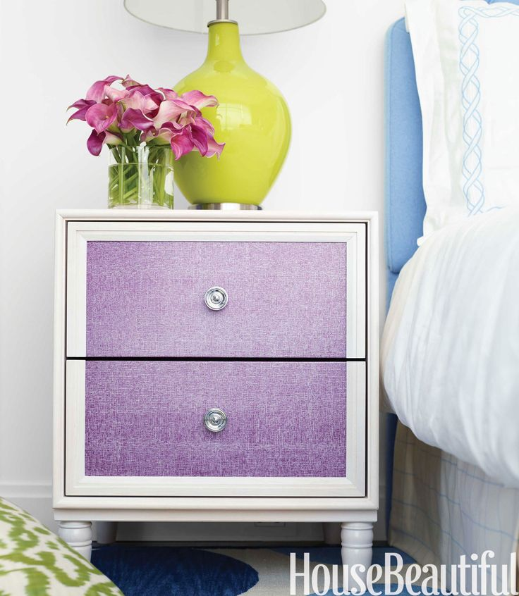 Purple drawer fronts on a side table by the New Traditionalists and the client's chartreuse lamp enliven the master bedroom in a Manhattan apartment decorated by Amanda Nisbet.   - HouseBeautiful.com