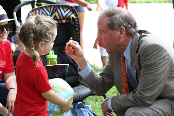 """After receiving a tiny white flower from Play-In participant, Kira, Senator Tom Udall (NM) thanked Moms for Clean Air and said, """"Taking action on climate change is important to me. It's important to all of us here. It may be the biggest man-made threat that we face."""""""