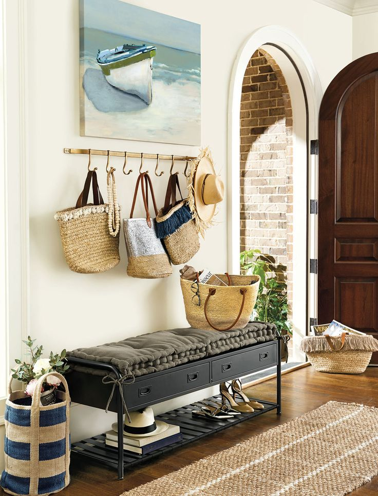A bench with drawers and hooks over top create a cute entryway that is chic enough for a front door that opens into your living room.