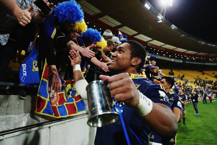 Waisake Naholo of the Highlanders celebrates with fans after winning the Super Rugby Final match between the Hurricanes and the Highlanders at Westpac Stadium in Wellington. Photo by Getty