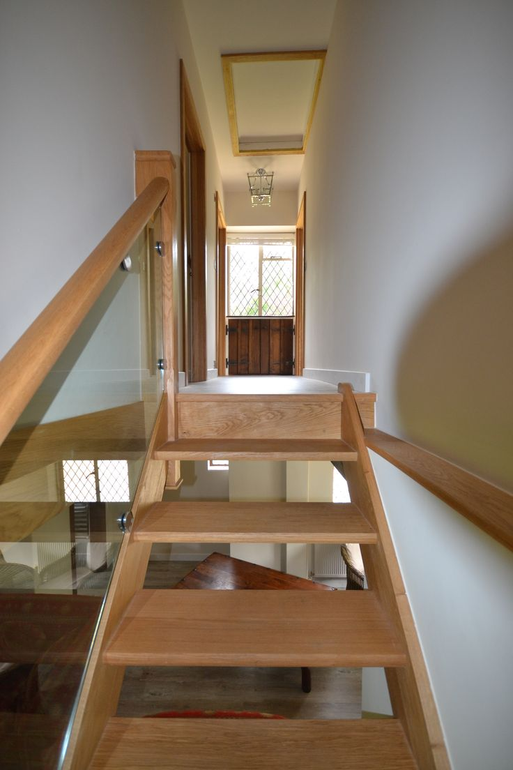 Straight oak staircase with glass balustrade - the perfect solution for homes which have adopted a minimalist approach.