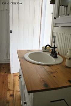FARMHOUSE 5540: Farmhouse Bathroom for the barn. A vintage-look vessel sink would look beautiful sitting atop that counter.