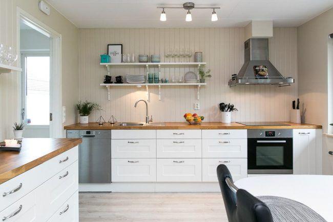 Стены кремового цвета в оформлении скандинавского интерьера кухни