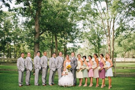 Light gray groomsmen attire and multi-color bridesmaid dresses // Jenelle Kappe Photography