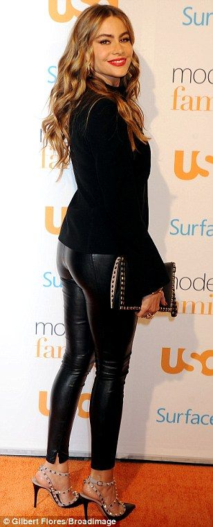 Sofia Vergara booty in tight leather pants and accentuated in a pair of studded Valentino pumps