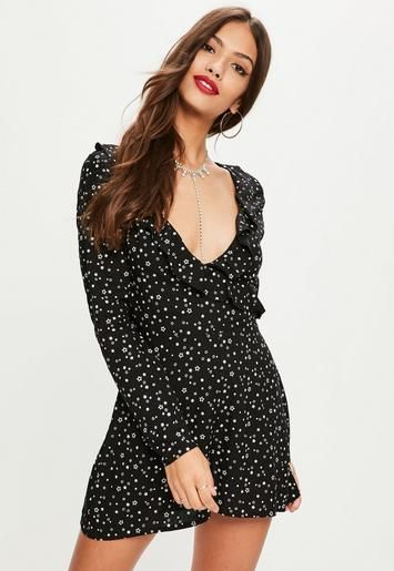 56c496b21 Black romper featuring a white star print