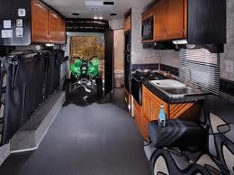 This is a TOY HAULER, an amazing RV that serves as a home, a vehicle and a garage at the same time. You can buy repo toy haulers at RV auctions.