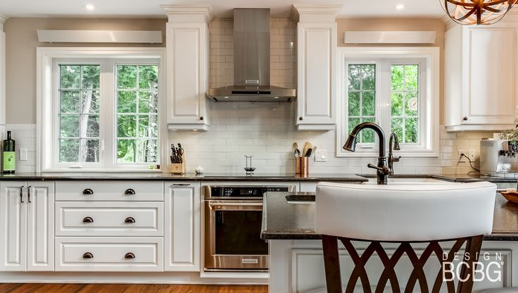 Country-style kitchen with maple cabinet painted in white lacquer.