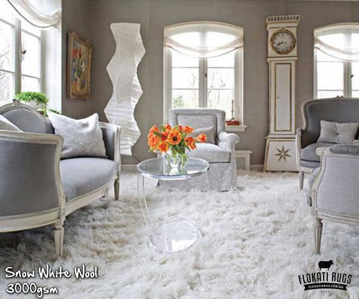 Living Room In Gray And White Set Off By Warm Walls A Large Flokati Rug Are Antique Sofa Chairs All Upholstered Narrow Striped