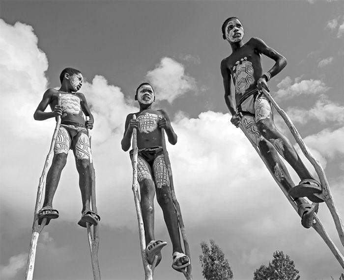 'Stilt Walkers' Third prize photo in the 'Prix de la Photographie Paris' competition by PCL tutor Tariq Zaidi, © Tariq Zaidi