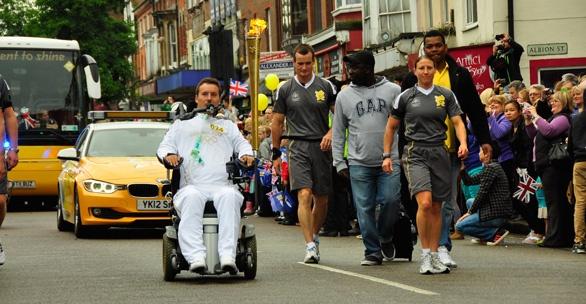 Variety, the Children's Charity, Ambassador Matt King is an Olympic Torchbearer through the town of Dunstable