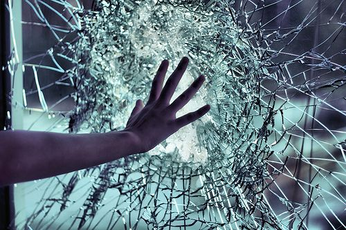 She was mad. That's all; she didn't know she possessed that type of strength. She figured she would break her hand, not the bullet proof glass.