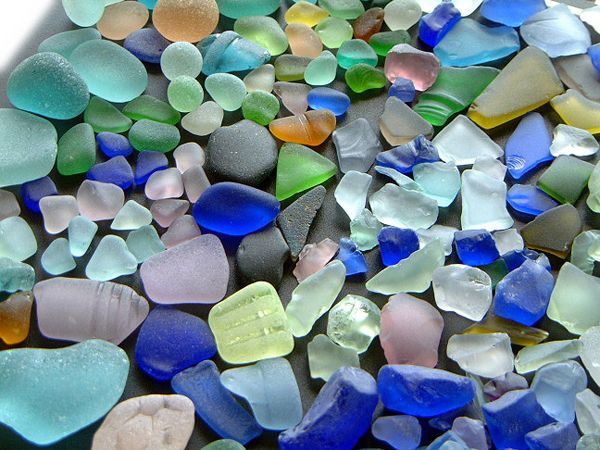 Real vs. artificial sea glass. Great info from the North American Sea Glass Association (copyrighted article). In this photo, genuine sea glass is on the left and artificially tumbled craft glass is on the right.