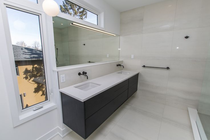 Double-vanity sink in Antilia Homes' 377 Dominion Avenue property, located in the trendy Westboro district of Ottawa