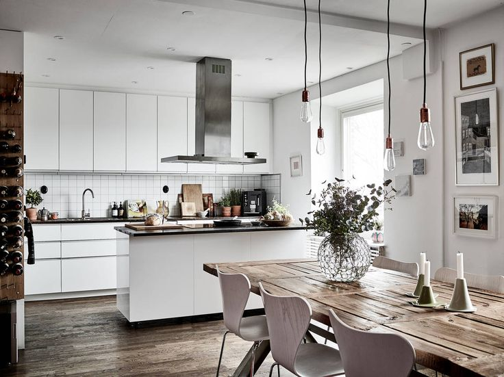 Modern white kitchen with big wooden table