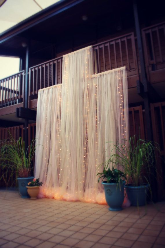 Beautiful backdrop for a ceremony or head table. Dramatic Tulle and Lights Wedding Ceremony by CraftyCousinsCo