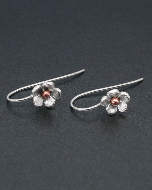A pair of charming handmade silver and copper flower earrings.  The single flowers are 10mm in diameter and are hand saw pierced from silver sheet with a copper bead at the centre. They hang from fixed silver hook fittings.  A brass bead at the centre is also available.  #copper #earrings #flower #handmade #silver #starboardjewellery #jewellery #cornwall #uk #gb #westcountry #devon #england #silversmith #pretty #jeweller #jewellers #handmadejewellery