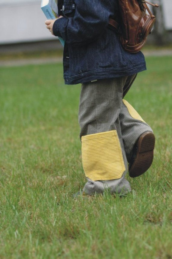 cotton grey cords with yellow pockets.
