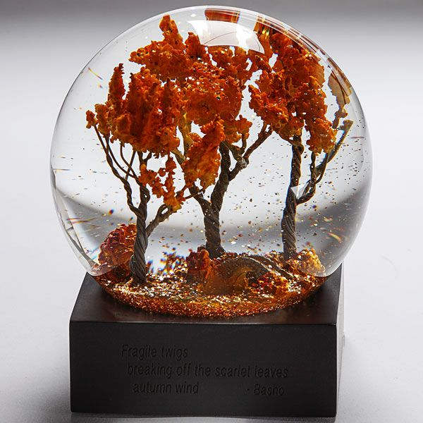 Autumn snow globe from the Smithsonian -- scarlet leaves and fiery sparkles