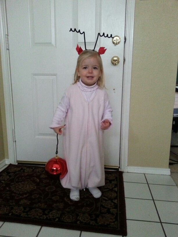 Cindy lou who costume using pink turtleneck, pink fleece sleep sack with foot holes, a handband with black pipecleaner antenna and red bows glued on, and a really big plastic tree ornament.