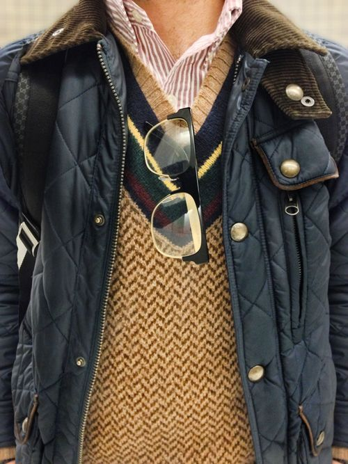 Casual, fall outfit...herringbone cricket-style v-neck sweater paired with a burgundy and cream striped button down and a blue quilted jacket with brown corduroy collar...