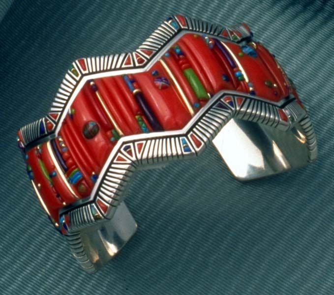 Cuff | Raymond Yazzie (Navajo). Silver inlaid with coral, lapis and turquoise | Unfortunately no link provided by original pinner