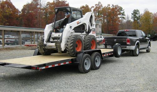 Our best selling model, the wood deck fixed front tilt equipment trailer hauling a Bobcat Skidsteer. Check out more equipment trailer models at www.laufmantrailers.com/equipment-trailers