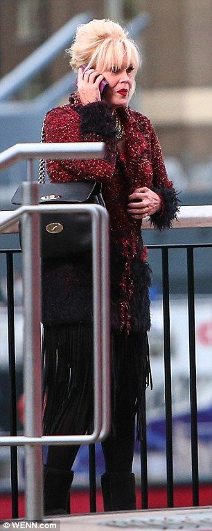 Chilly Joanna Lumley gets a warm hug during Ab Fab filming