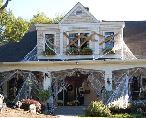 outdoor halloween decor. Can be made more Zombie apocalypse-ish by adding any zombies to the front. You can have arms poking out of the windows as if they've already gotten in.