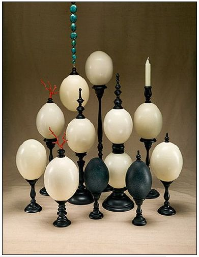 Yikes, these are curious and amazing. Mounted ostrich eggs from ruzzetti and gow. Strange, and almost a little disturbing for some reason. But come on, an egg topped with coral, mounted on a turned, black finial. Pretty wild and ok,...