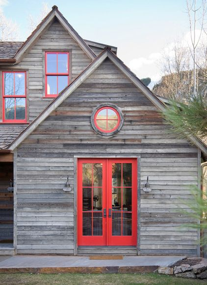 red trim door and windows - rustic exterior by Bob Greenspan Photography